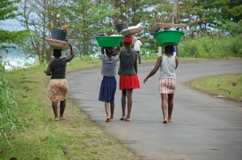 Girls carrying clothes